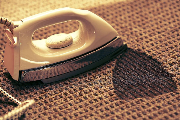 ترمیم سوختگی فرش با اتو